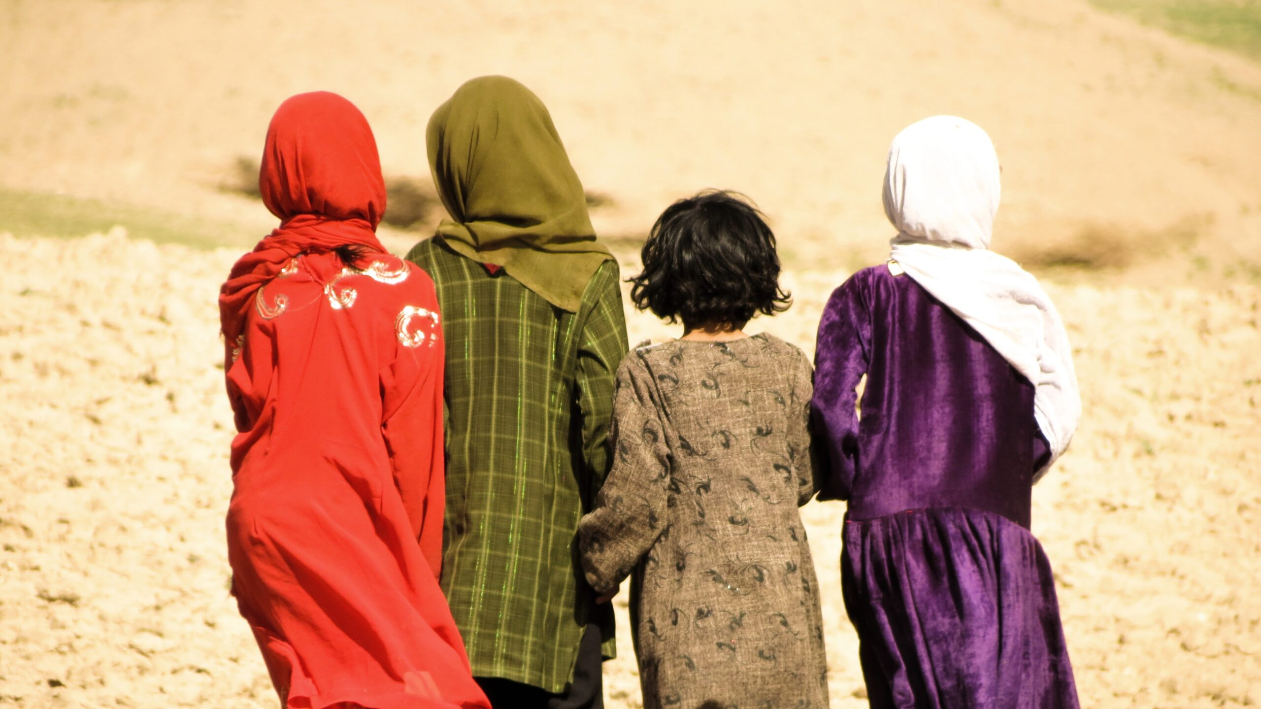 Chagcharan, Afghanistan - August 25, 2012: Four Afghanistan girls walking in the mountains.
